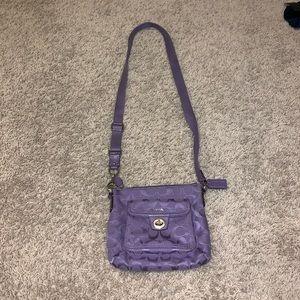 Cross body Coach purse.